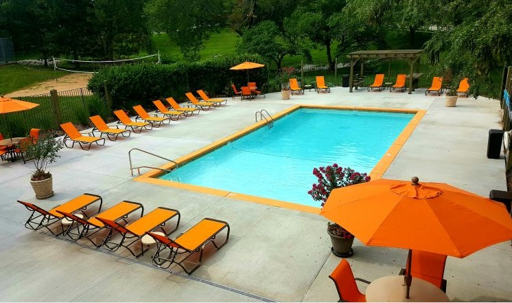 Renovated pool with new furniture at The Retreat at Woodridge Apartments in Lenexa, KS