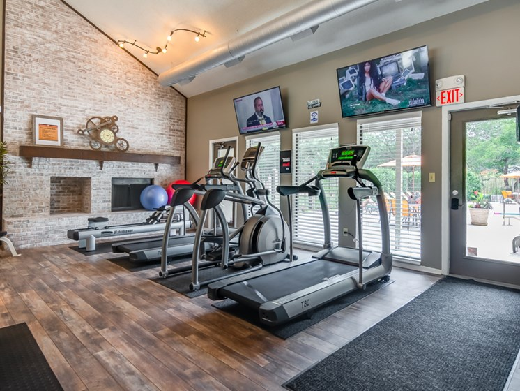 Treadmill and elliptical at The Retreat at Woodridge Apartments in Lenexa, KS