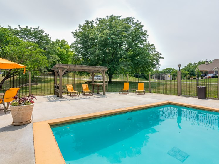 Outdoor pool gazebo at The Retreat at Woodridge Apartments in Lenexa, KS