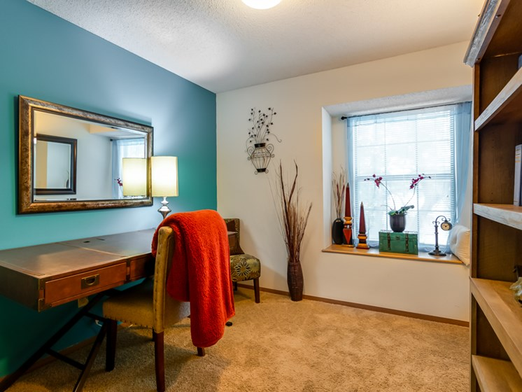 Office or guest bedroom with window seat at The Retreat at Woodridge Apartments in Lenexa, KS