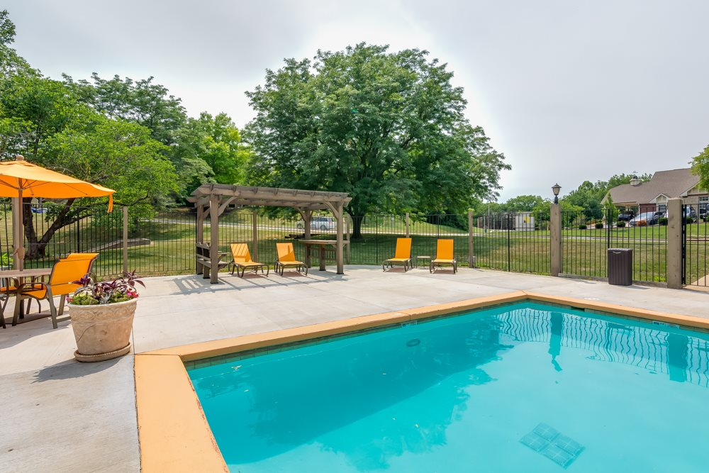 Tanning sundeck by pool at The Retreat at Woodridge in Lenexa, KS