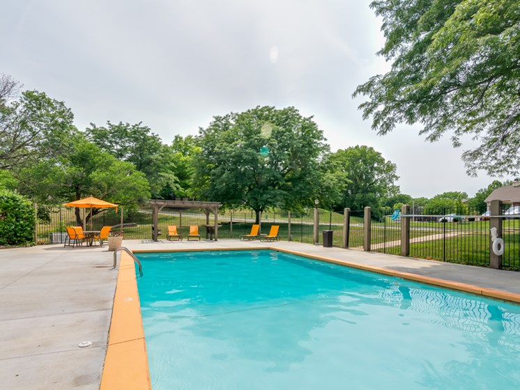 Clear blue sparkling pool at The Retreat at Woodridge Apartments in Lenexa, KS