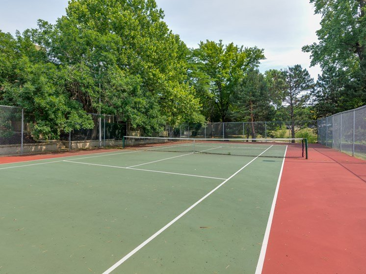 Huge enclosed tennis court at The Retreat at Woodridge Apartments in Lenexa, KS