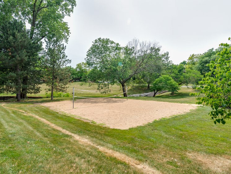 Sand volleyball court at The Retreat at Woodridge Apartments in Lenexa, KS