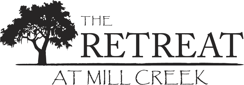 Property logo at The Retreat at Mill Creek Apartments in Lenexa, KS
