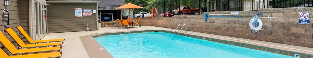 Apartments with pool at The Retreat at Woodlands Apartments in South Kansas City, MO
