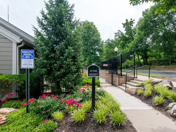 Beautiful foliage flowers and plants at the leasing office at The Retreat at Woodlands Apartments in South Kansas City, MO