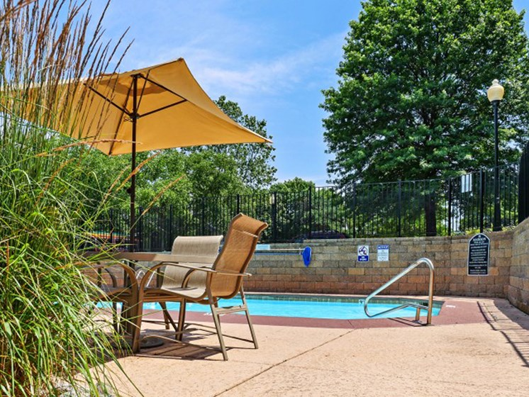 Tanning sundeck by pool at The Retreat at Woodlands Apartments in South Kansas City, MO
