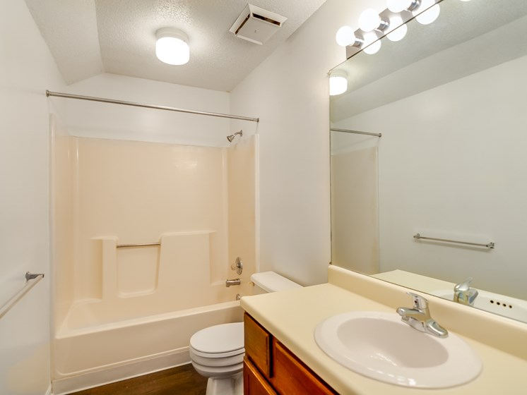 Huge vanity and mirror in the bathroom at The Retreat at Woodlands Apartments in South Kansas City, MO