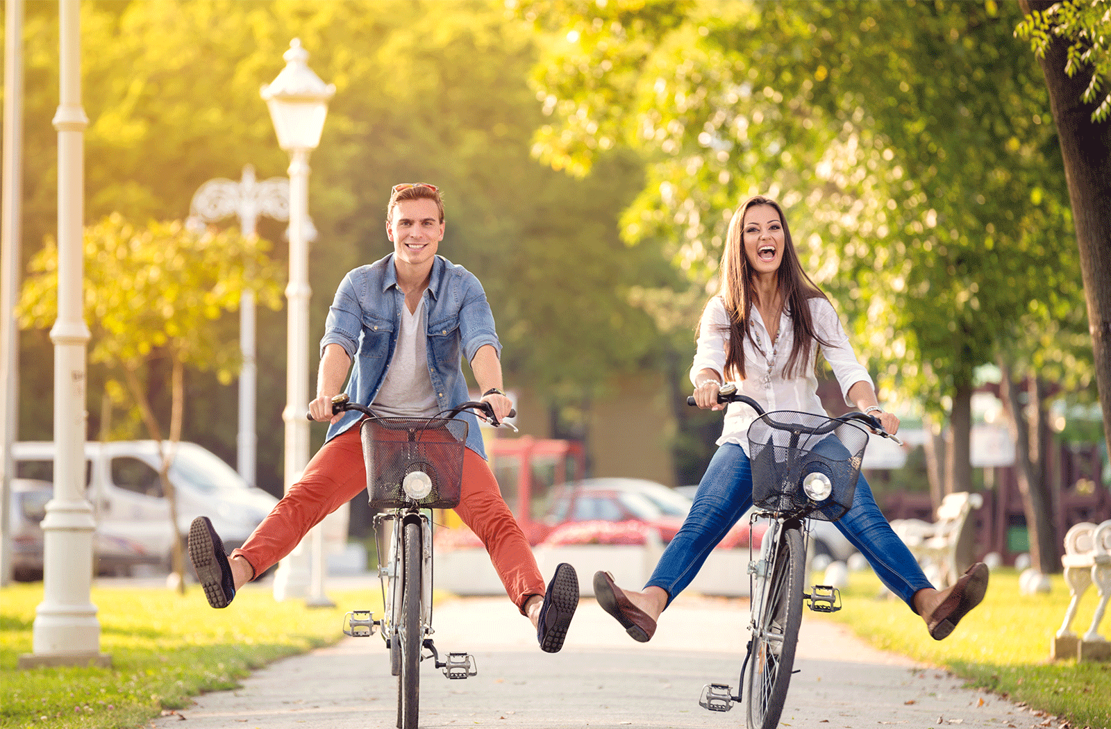 Couple riding bikes and laughing