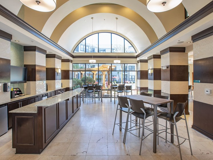 Clubhouse Cafe with seating area. Granite counter top area holds kitchen sink.