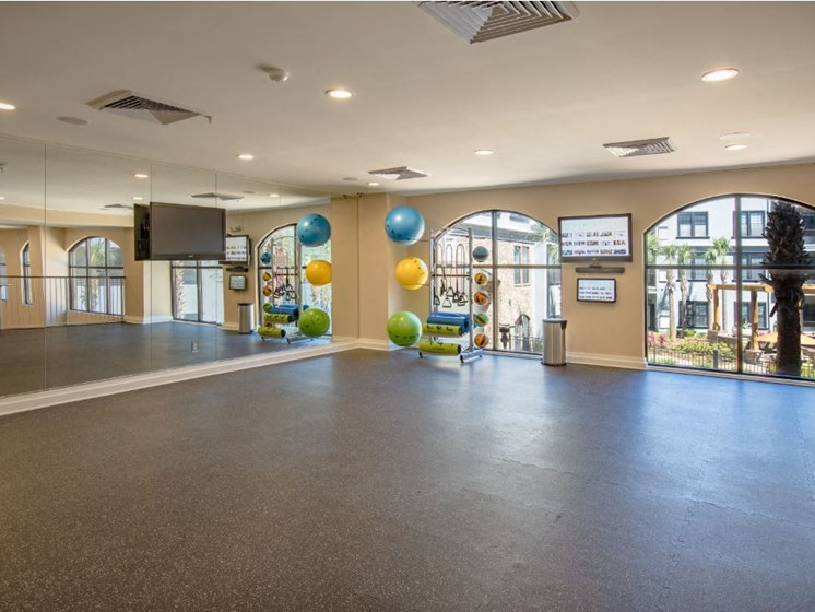 2nd floor of Fitness Center with wall to wall mirror and WellBeats virtual trainer. Exercise balls and yoga mats available.