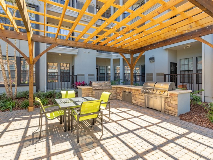 Courtyard pool BBQ Grill area with outdoor seating.