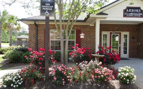clubhouse flowers in front of handicapped parking area