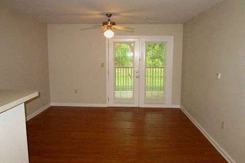 living room with double doors leading to deck