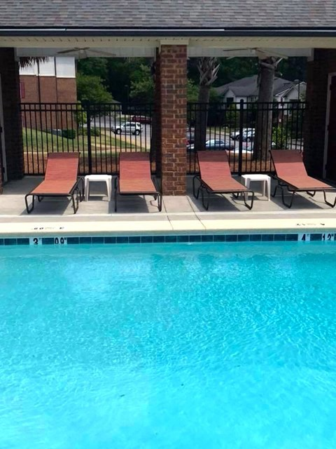 Arbors By The Bay Apartment Homes Daphne AL 36526 sparkling pool with lounge furniture