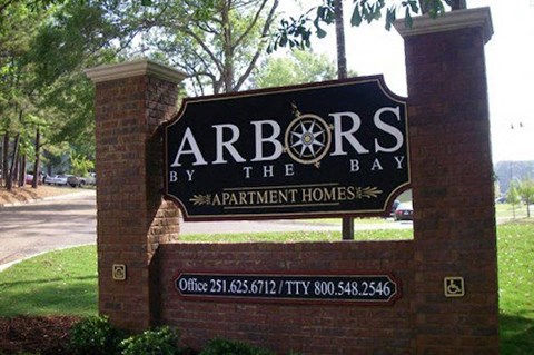 Entrance sign at Arbors By The Bay Apartment Homes Daphne AL 36526