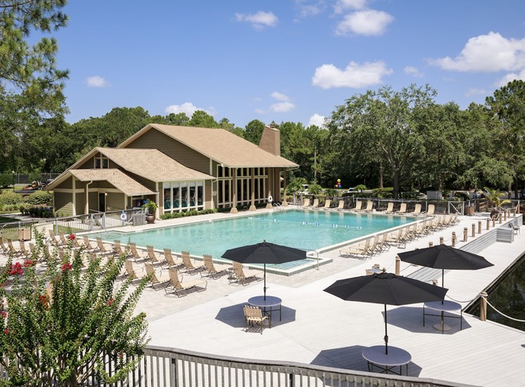Olympic Sized Pool with expansive sundeck by clubhouse