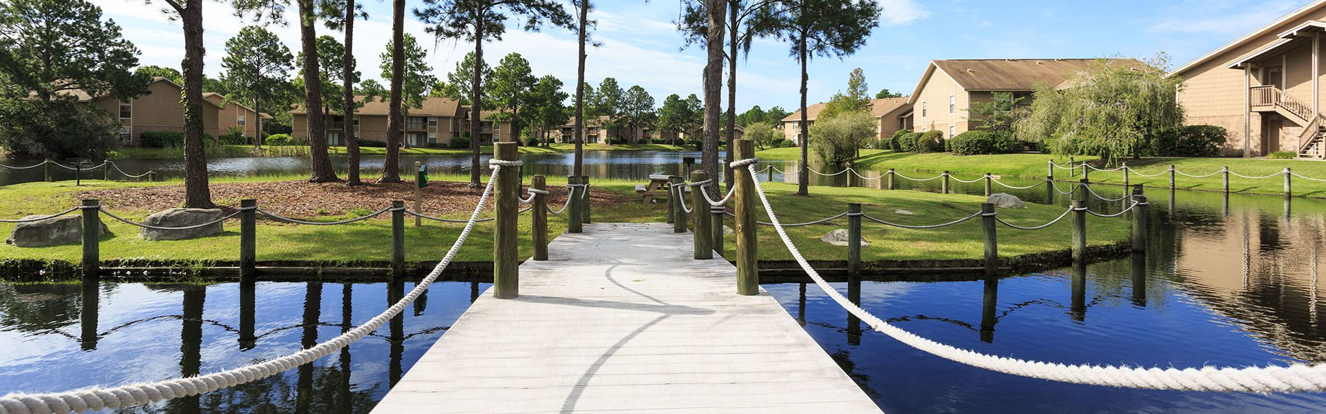 Whisper Lake apartments in winter park, orlando , florida  32792 walkway to bbq island