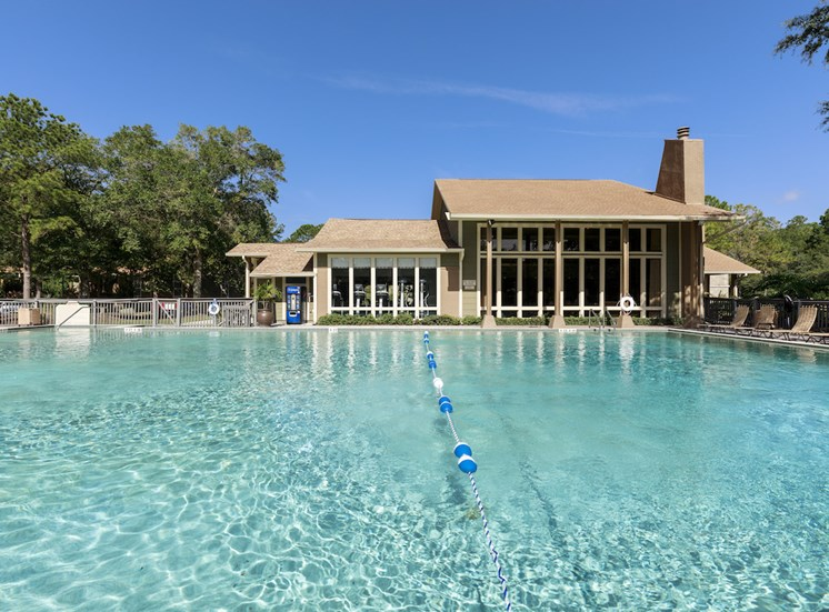 view of clubhouse from pool's far side