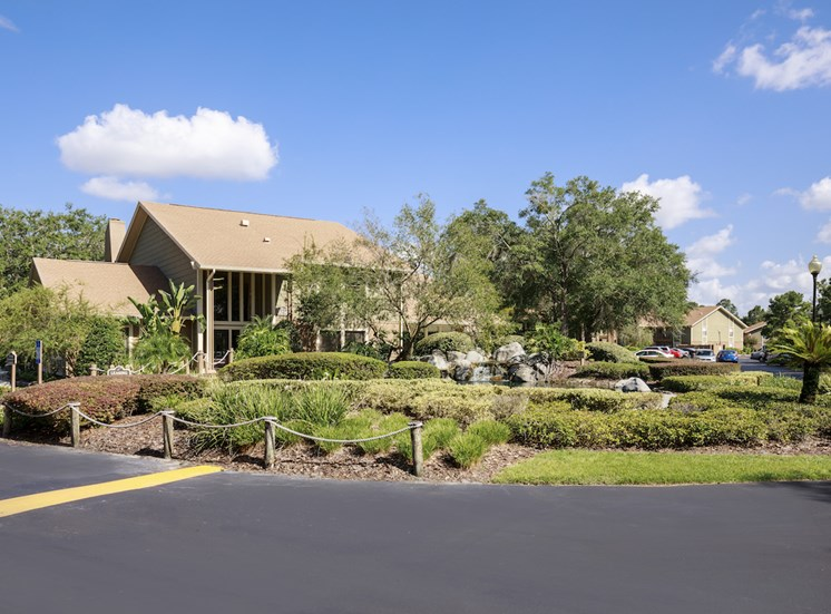 Whisper Lake clubhouse and lush landscaping from parking lot