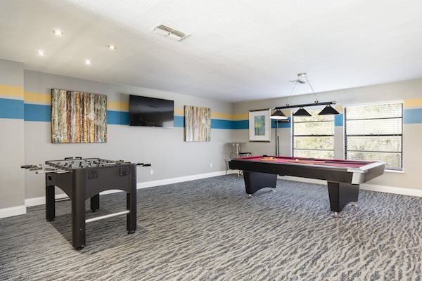 Whisper Lake apartments in winter park, orlando , florida  32792 game room with billiards and fooseball