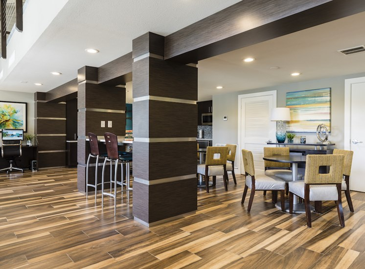 clubhouse kitchen lounge area with tables and chairs