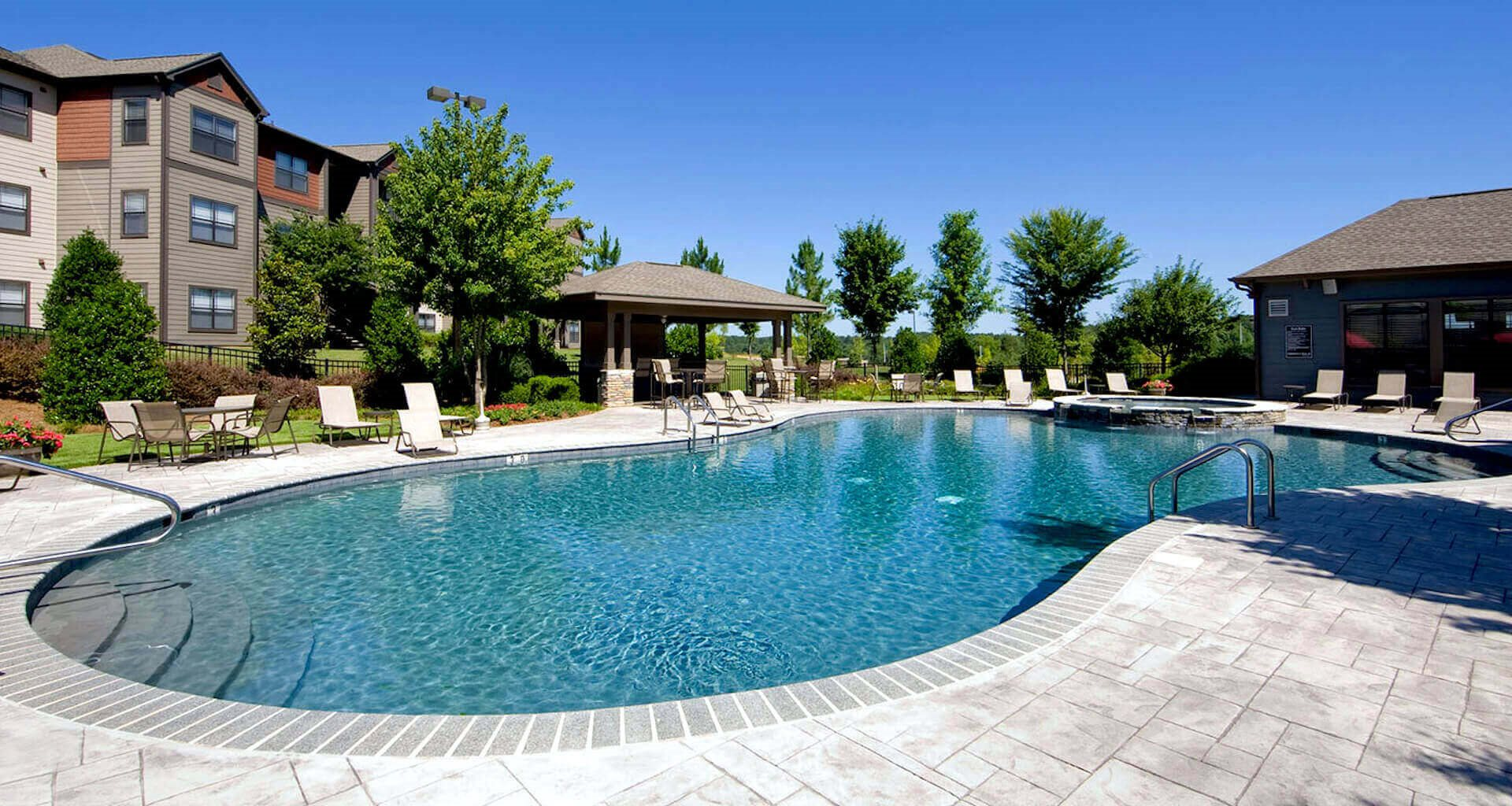 beautiful resort-style pool with expansive sundeck
