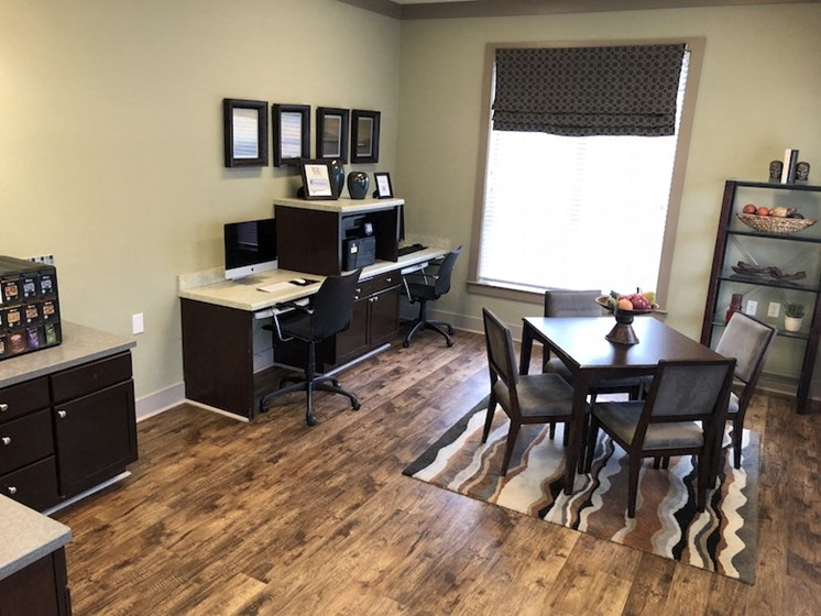 Bridgewater Apartmets in Huntsville, Alabama new hardwood-style flooring in business center