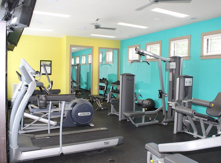 24-hour fitness center with cardio and weight equipment