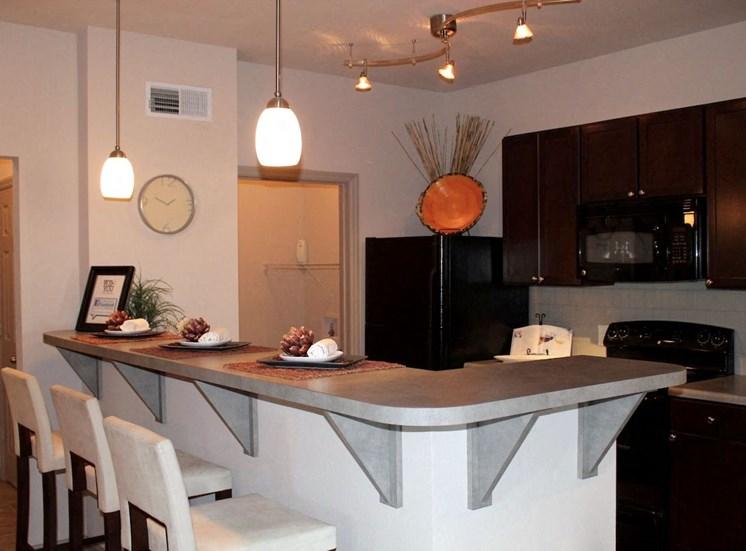 Bridgewater apartments in huntsville, al 35806 kitchen bar and black appliances