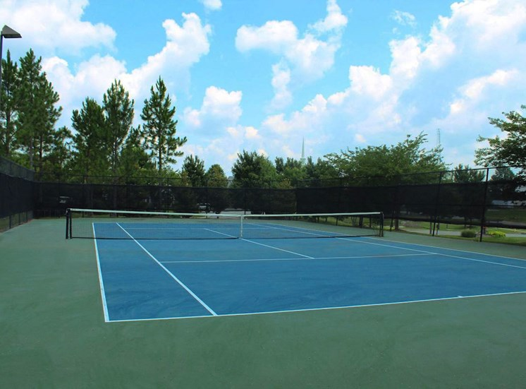 illuminated tennis court blue and green surface