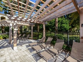 Pool Cabana & Outdoor Entertainment Bar at Legacy at Fort Clarke apartments in Gainesville, Florida 32606