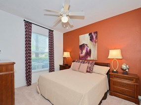 Live in cozy bedrooms at Legacy at Fort Clarke apartments in Gainesville, Florida 32606