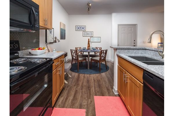 Legacy at Fort Clarke apartments in Gainesville, Florida 32606 hardwood-inspired flooring