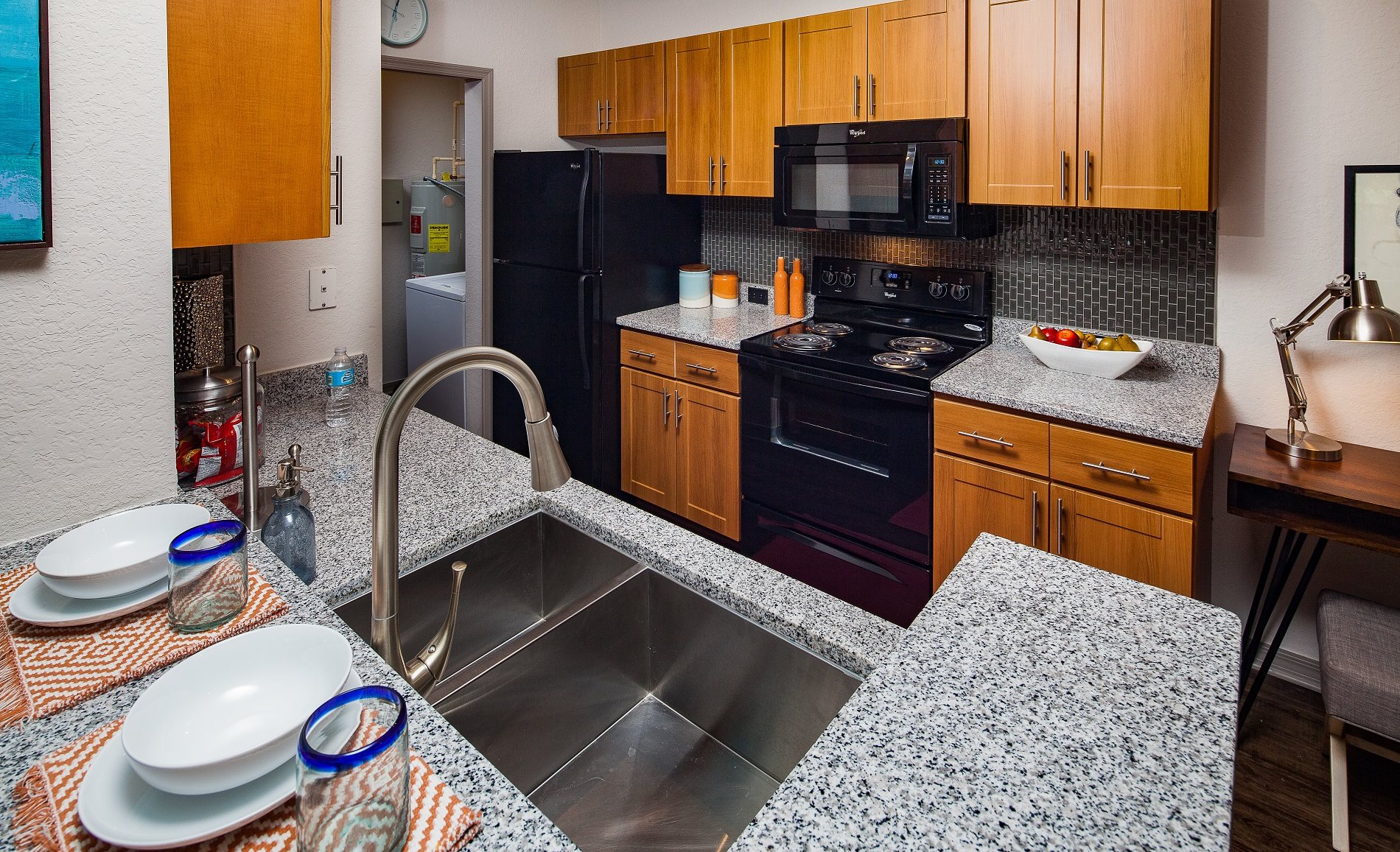 Gourmet kitchen with granite countertops at Legacy at Fort Clarke apartments in Gainesville, Florida 32606