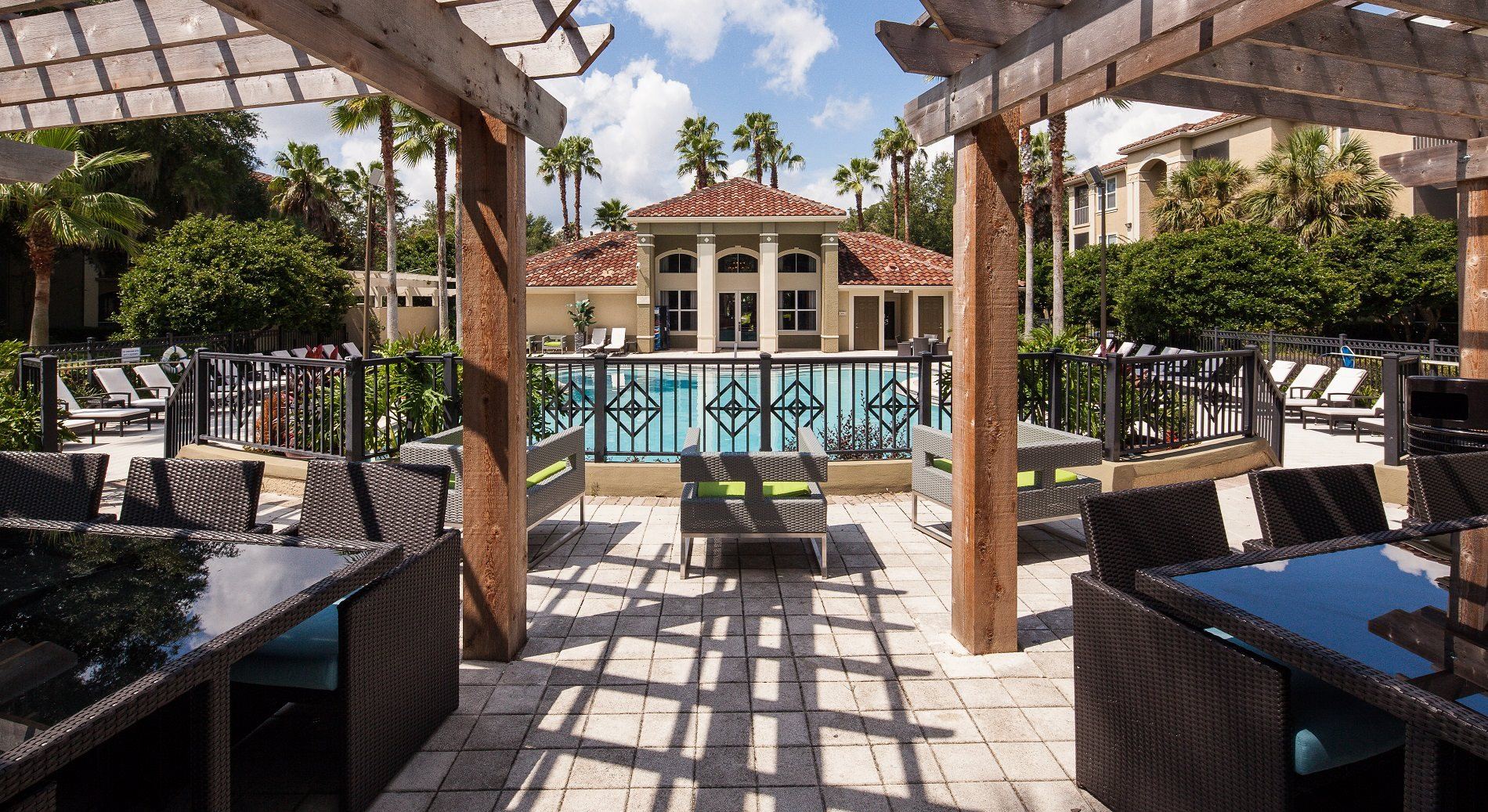Grand resort-style swimming pool with large aqua deck and outdoor seating at Legacy at Fort Clarke, Gainseville, FL, 32606