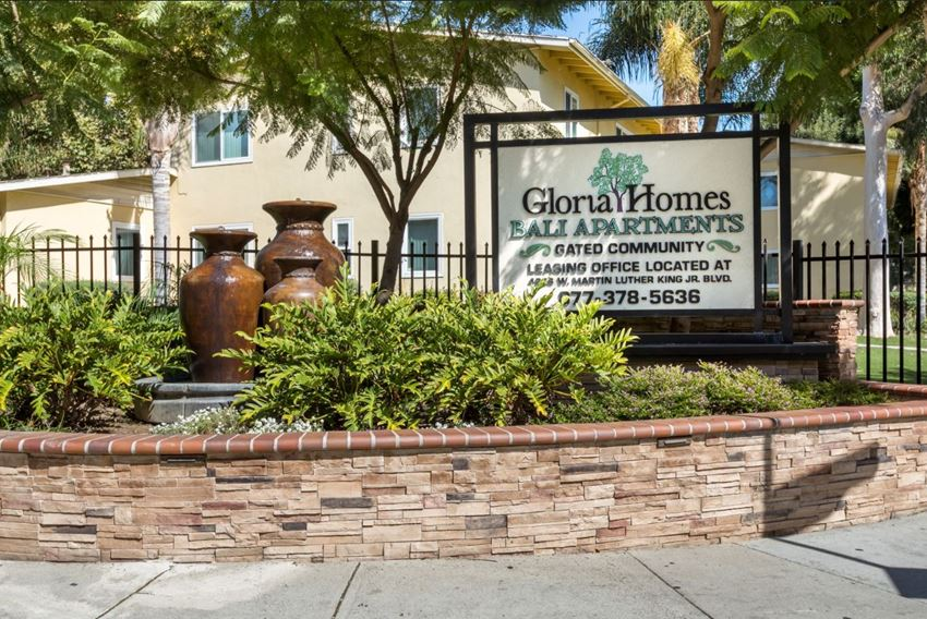 Apartments in Baldwin Village for Rent - Gloria Homes Apartments Monument Sign Surrounded by Lush Landscaping