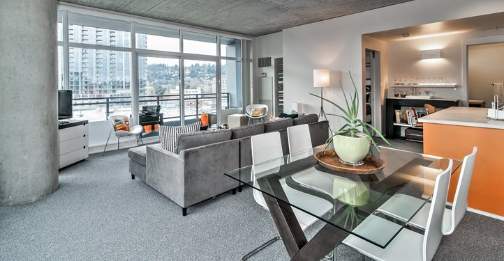 Living Room With Dining Space at The Louisa Apartments in Portland, Oregon