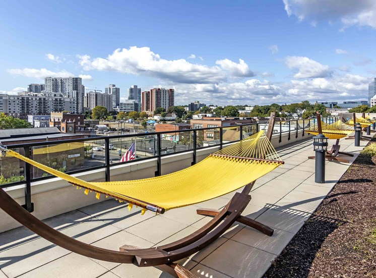 Yellow hammock on pool deck with views of skyline