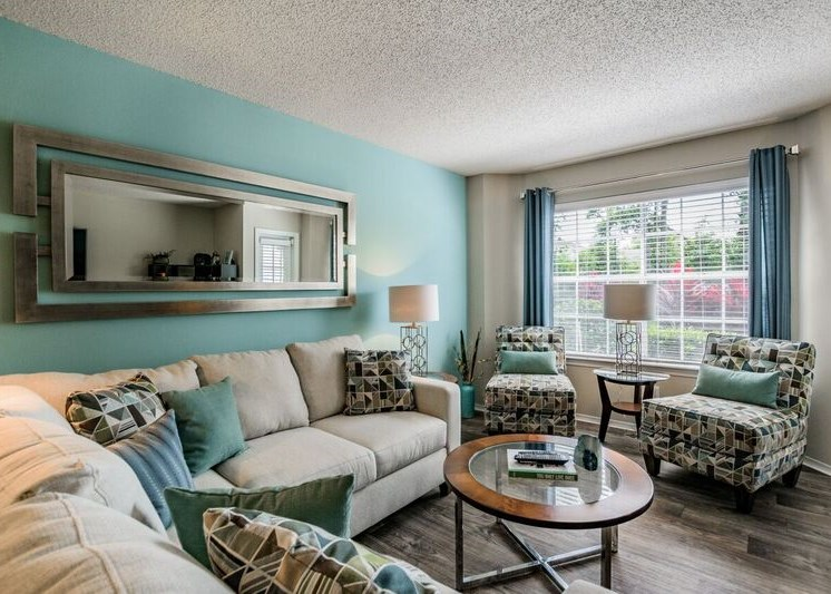 Living Room With Expansive Window at Enclave at Lake Underhill, Orlando