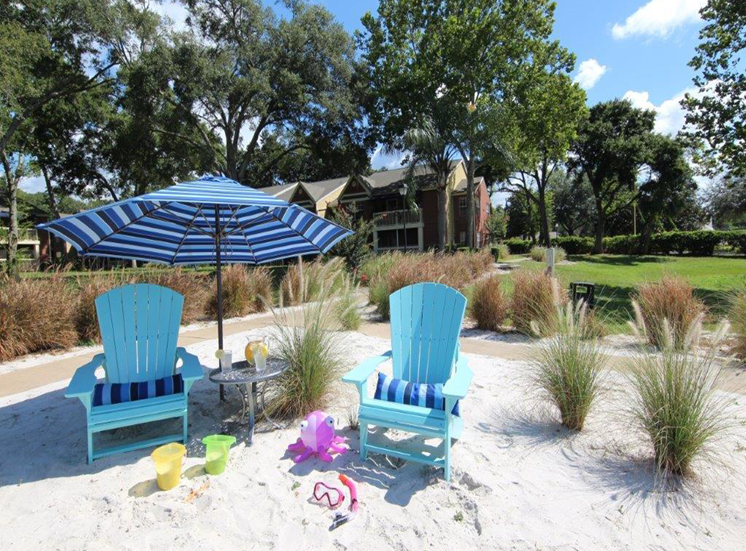 Beach Sand With Chairs at Enclave at Lake Underhill, Florida, 32803