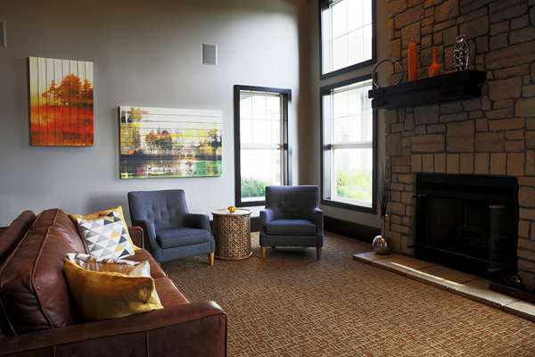 Furnished Living room With Fire Place at Main Street Village Apartments, Indiana 46530
