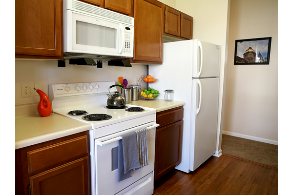 Spacious Kitchen with Pantry Cabinet at Main Street Village Apartments, Indiana, Granger