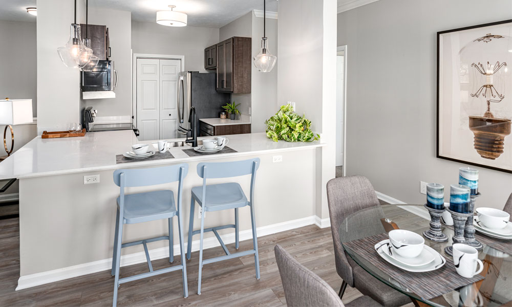 Well Equipped Kitchen And Dining at Main Street Village Apartments, Granger, IN