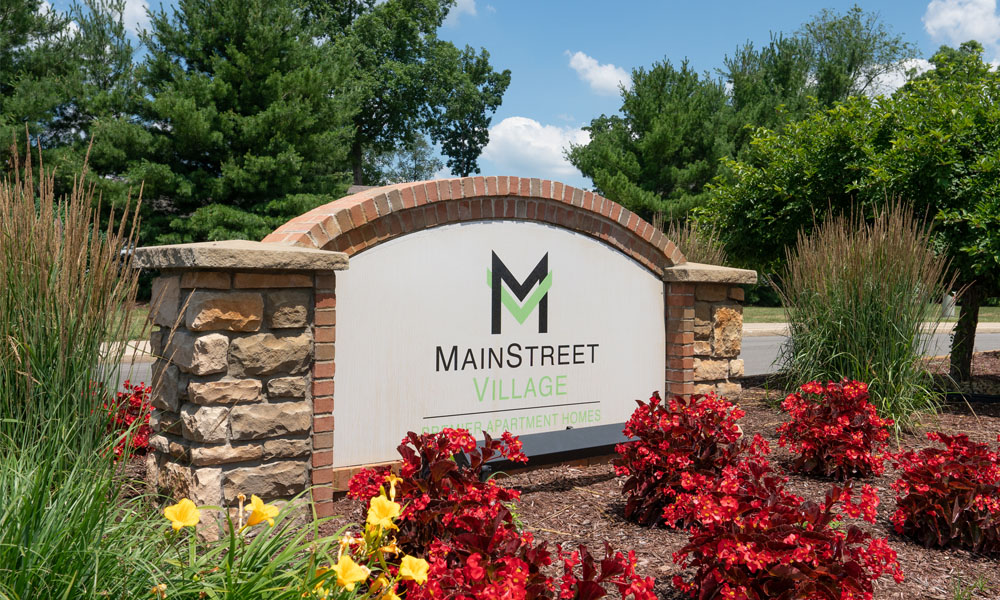 Welcoming Property Signage at Main Street Village Apartments, Granger