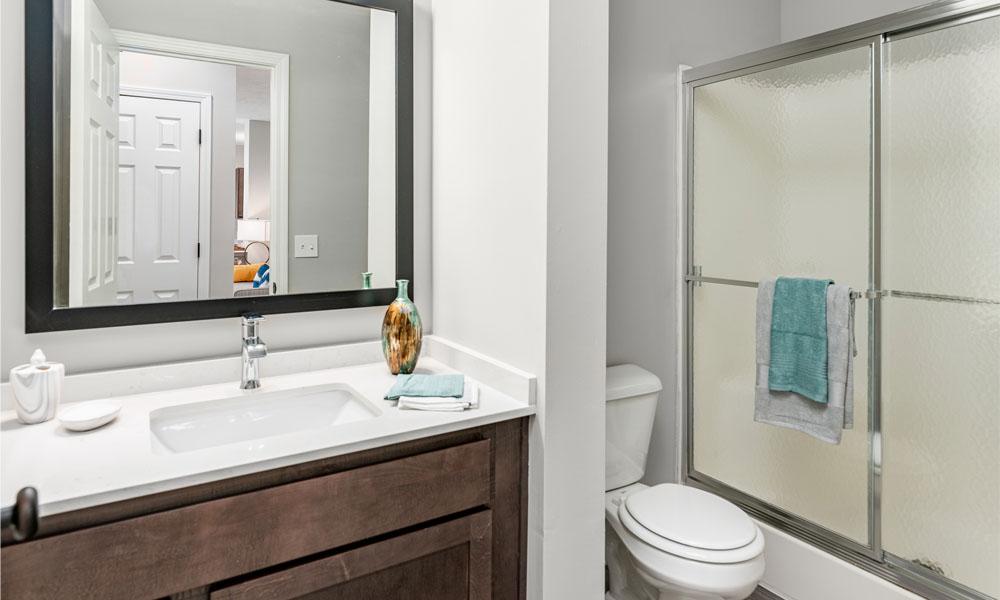 Designer Granite Countertops In All Bathrooms at Main Street Village Apartments, Granger, Indiana