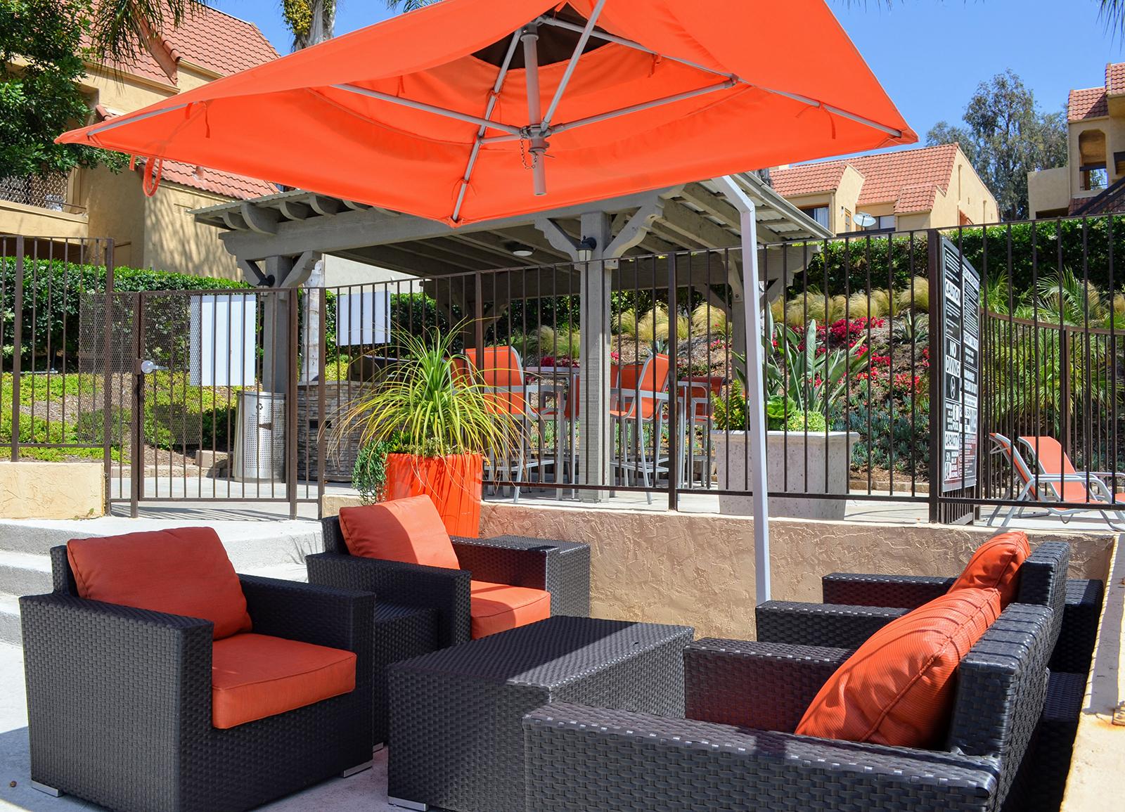 Lounge Chairs with Shade Awning at Canyon Villa Apartments, 601 Telegraph Canyon Road, California