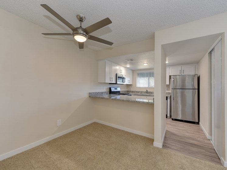 Luxury Apartment Community Dining Area and Kitchen with Stainless Steel Appliances