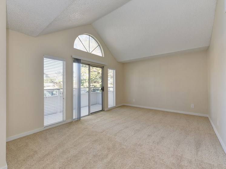 Luxury Apartment Community Living Room with Vaulted Ceiling and Private Patio or Balcony